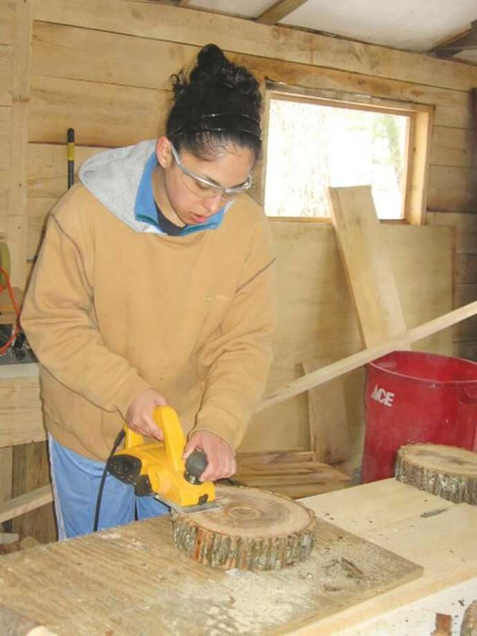 Submitted Photo Dannah Ortiz, a Quinnipiac University student, works at an Alternative Spring Break trip at the Camp Norwich YMCA of Northampton, Mass., the oldest YMCA Camp in the country.