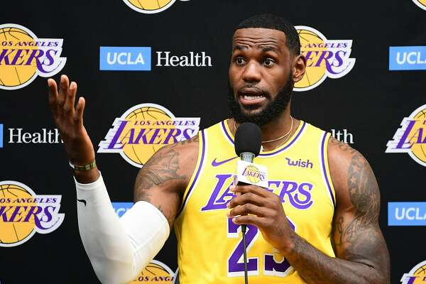 "(FILES) In this file photo taken on September 27, 2019 Laker forward LeBron James speaks during the Los Angeles Lakers media day in El Segundo, California. - Basketball superstar LeBron James on October 14, 2019, has sharply criticised a Houston Rockets executive for angering China with a tweet supporting protesters in Hong Kong, saying the executive was ""misinformed"" and should have kept his mouth shut. (Photo by FREDERIC J. BROWN / AFP) (Photo by FREDERIC J. BROWN/AFP via Getty Images)"