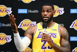 """(FILES) In this file photo taken on September 27, 2019 Laker forward LeBron James speaks during the Los Angeles Lakers media day in El Segundo, California. - Basketball superstar LeBron James on October 14, 2019, has sharply criticised a Houston Rockets executive for angering China with a tweet supporting protesters in Hong Kong, saying the executive was """"misinformed"""" and should have kept his mouth shut. (Photo by FREDERIC J. BROWN / AFP) (Photo by FREDERIC J. BROWN/AFP via Getty Images)"""