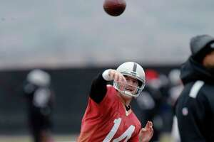 Former NFL quarterback Matt McGloin, seen here practicing with the Oakland Raiders, will play for the XFL's New York Guardians.