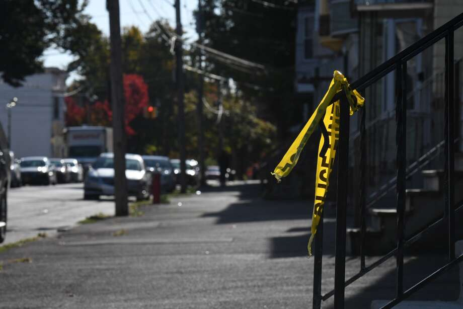 Scraps of police tape remain at he scene where a 20-year-old man was shot and killed Monday on Second Street between Judson Street and North Lake Avenue. The killing was Albany's second homicide of the year. Photo: Will Waldron / Times Union