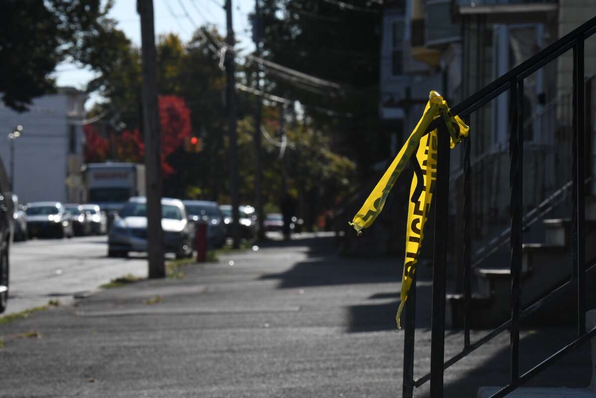 Scraps of police tape remain at he scene where a 20-year-old man was shot and killed Monday on Second Street between Judson Street and North Lake Avenue. The killing was Albany's second homicide of the year.