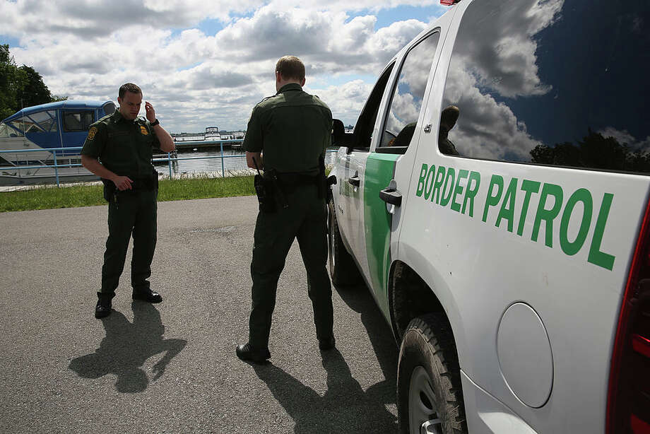 U.S. Border Patrol agents talk while at a marina on the Niagara River at the U.S.-Canada border on June 3, 2013 in Beaver Island State Park, New York. U.S. Customs and Border Protection, which includes the Border Patrol, monitors the 5,525 mile long border, including Alaska, forming the longest international border between two countries in the world. Photo: John Moore/Getty Images / 2013 Getty Images