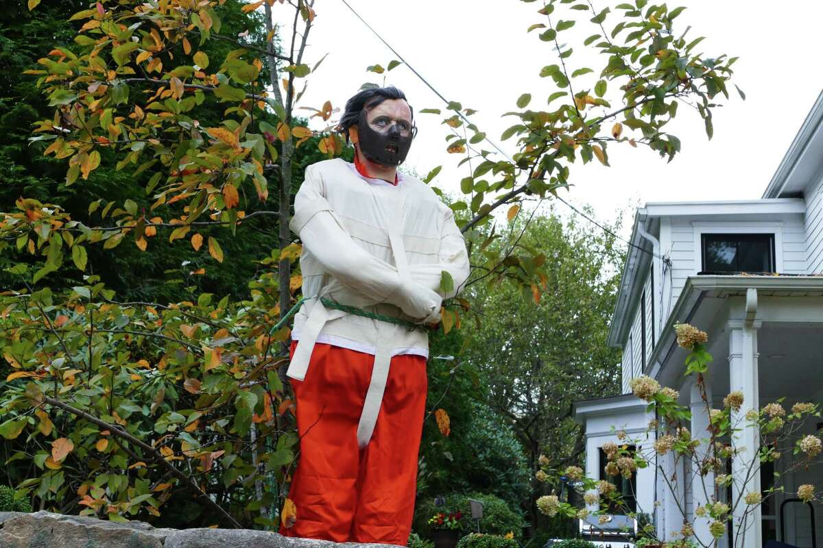 Two Hannibal Lecter figures visit Church Street in New Canaan during the Halloween season and move positions. Picture was taken Oct. 12, 2019.