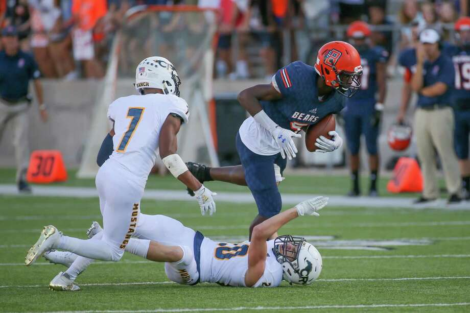 Bridgeland wide receiver Dylan Goffney (5) leaps over Cypress Ranch linebacker Alex Garcia (20) in the first quarter of a high school football game, Saturday, Sept. 21, 2019 in Cypress, TX. Photo: Leslie Plaza Johnson, Freelancer / Contributor / Houston Chronicle
