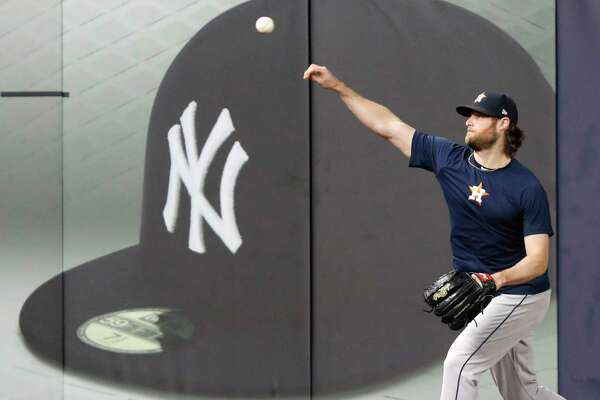 Houston Astros Game 3 starting pitcher Gerrit Cole throws on the field at Yankee Stadium, Monday, Oct. 14, 2019, in New York, after the team arrived to prepare for the American League Championship Series which continues Tuesday against the New York Yankees. (AP Photo/Kathy Willens)