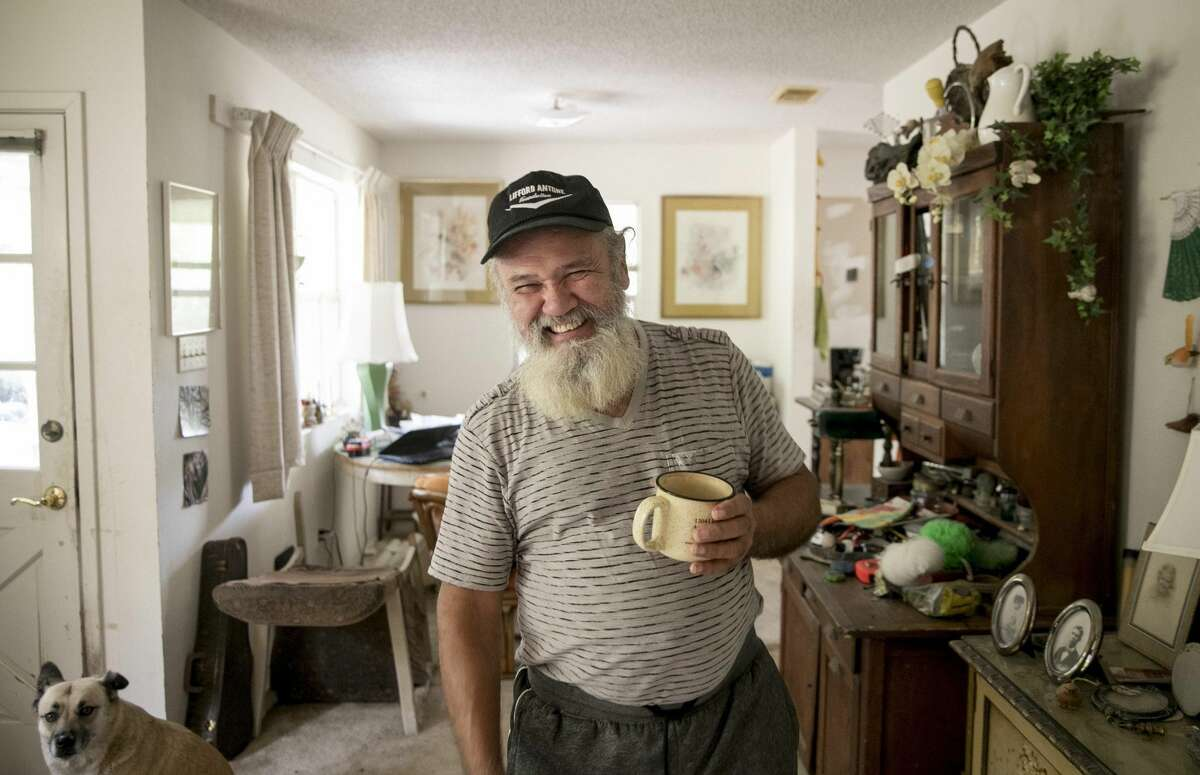 Coy Featherston relaxes with a cup of coffee at the home of his longtime friend Don Vanderburg in Lago Vista on Wednesday. Featherston, 68, who has been homeless since 1995, is now living with Vanderburg.
