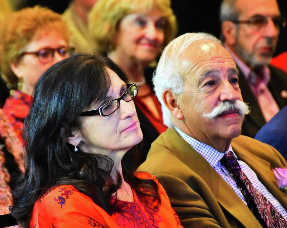 Donna Purnomo, left, a founder ofAlbany Chef's Food & Wine Festival: Wine & Dine for the Arts, sits with restaurateur and veteran auctioneer for local charities LeGrande Serras during a news conference Tuesday, Oct. 15, 2018, at the Albany Capital Center in Albany during which details of the 2020 festival were announced. The Purnomo family will be honored at the festival for their role in running Wine & Dine for the Arts during its first decade, as will Serras, whose auctions have raised more than $26 million over the years for regional not-for-profit organizations.