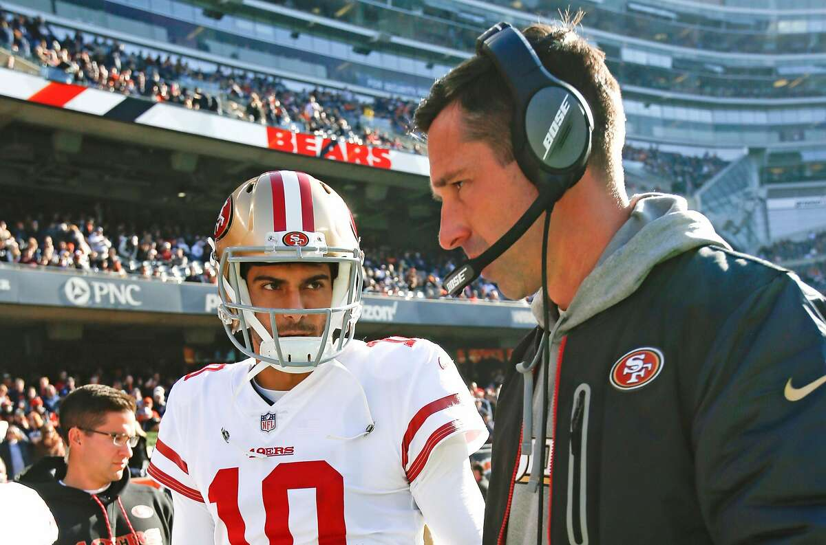 CHICAGO, IL - DECEMBER 3: Jimmy Garoppolo #10 and Head Coach Kyle Shanahan of the San Francisco 49ers talk on the sideline prior to the game against the Chicago Bears at Soldier Field on December 3, 2017 in Chicago, Illinois. The 49ers defeated the Bears