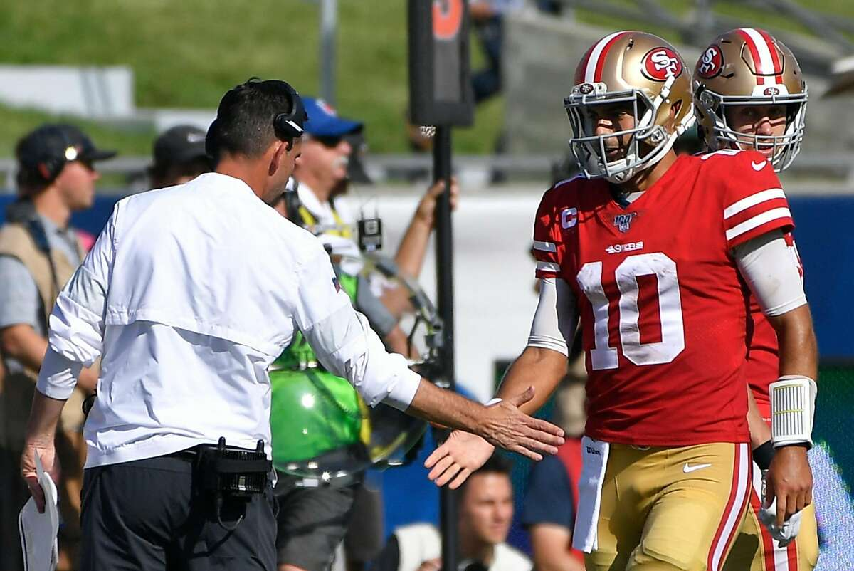 LOS ANGELES, CA - OCTOBER 13: Jimmy Garoppolo #10 of the San Francisco 49ers is congratulated on his third-quarter touchdown against the Los Angeles Rams by head coach Kyle Shanahan at Los Angeles Memorial Coliseum on October 13, 2019 in Los Angeles, California. (Photo by John McCoy/Getty Images)