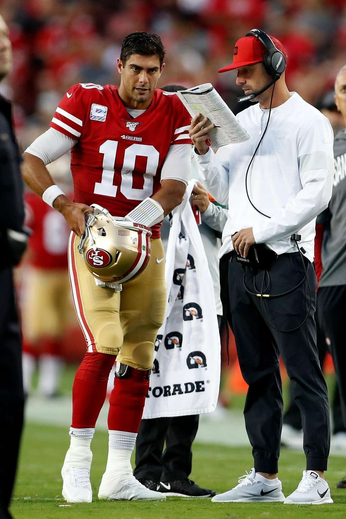 San Francisco 49ers' Jimmy Garoppolo and head coach Kyle Shanahan in 2nd quarter of 31-3 win during NFL game at Levi's Stadium in Santa Clara, Calif., on Monday, October 7, 2019.