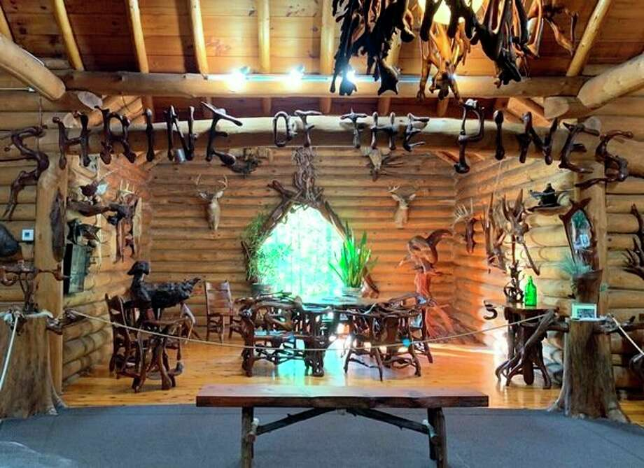 The Shrine of the Pines museum in Baldwin showcases the works of Raymond Overholzer who carved pieces from pine roots and stumps. Each of the letters in the sign shown was carved from a single piece of root. (Star photo/Cathie Crew)
