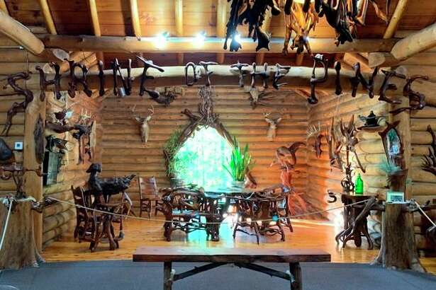 The Shrine ofthe Pines museum in Baldwin showcases the works of Raymond Overholzer who carved pieces from pine roots and stumps. Each of the letters in the sign shown was carved from a single piece of root. (Star photo/Cathie Crew)