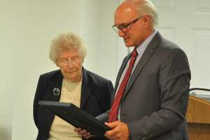 Christine Robertson was honored by First Selectman Rudy Marconi for her service to the town through years of work on the Commission on Aging. Fellow commission members Kathleen Brennan and Mary Ann O'Grady were also recognized..