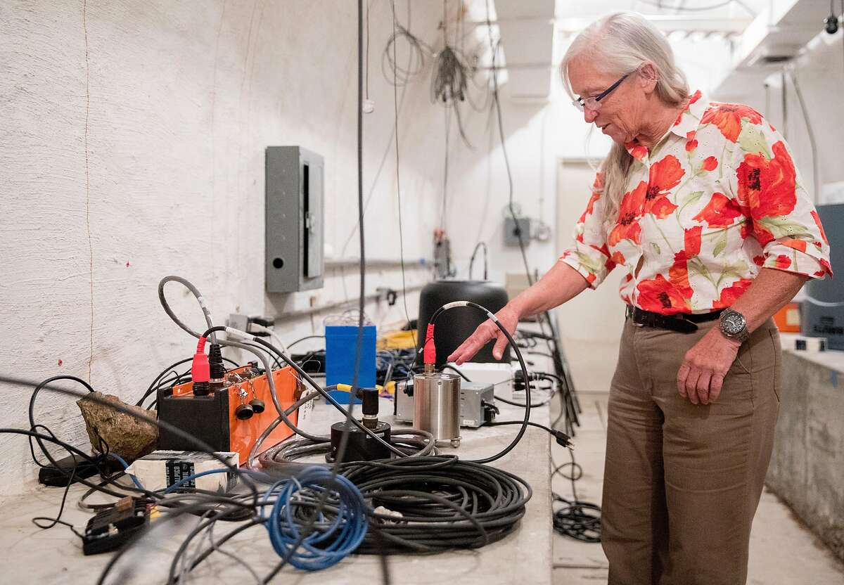 Seismologist Peggy Hellweg observes seismic instruments while inside the Byerly Vault in the hills near UC Berkeley in Berkeley, Calif. Tuesday, Oct. 8, 2019.