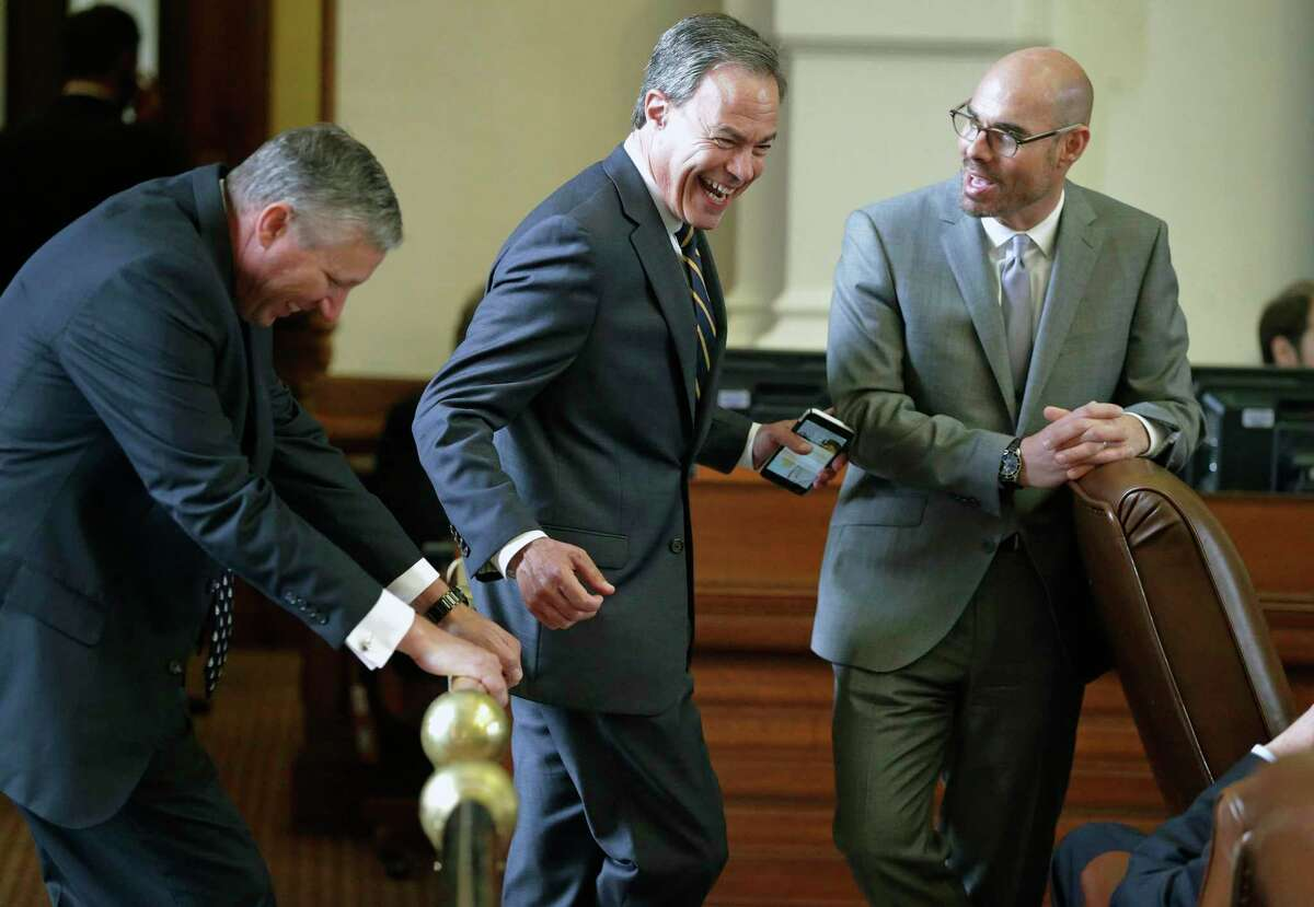 Speaker Joe Straus shares some laughs on the rail with Representative Drew Springer, R-Gainesville (left), and Representative Dennis Bonnen, R-Angleton during the Texas House of Representatives meeting on April 19, 2017.