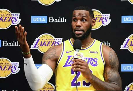 """(FILES) In this file photo taken on September 27, 2019 Laker forward LeBron James speaks during the Los Angeles Lakers media day in El Segundo, California. - Basketball superstar LeBron James on October 14, 2019, has sharply criticised a Houston Rockets executive for angering China with a tweet supporting protesters in Hong Kong, saying the executive was """"misinformed"""" and should have kept his mouth shut. (Photo by FREDERIC J. BROWN / AFP)"""