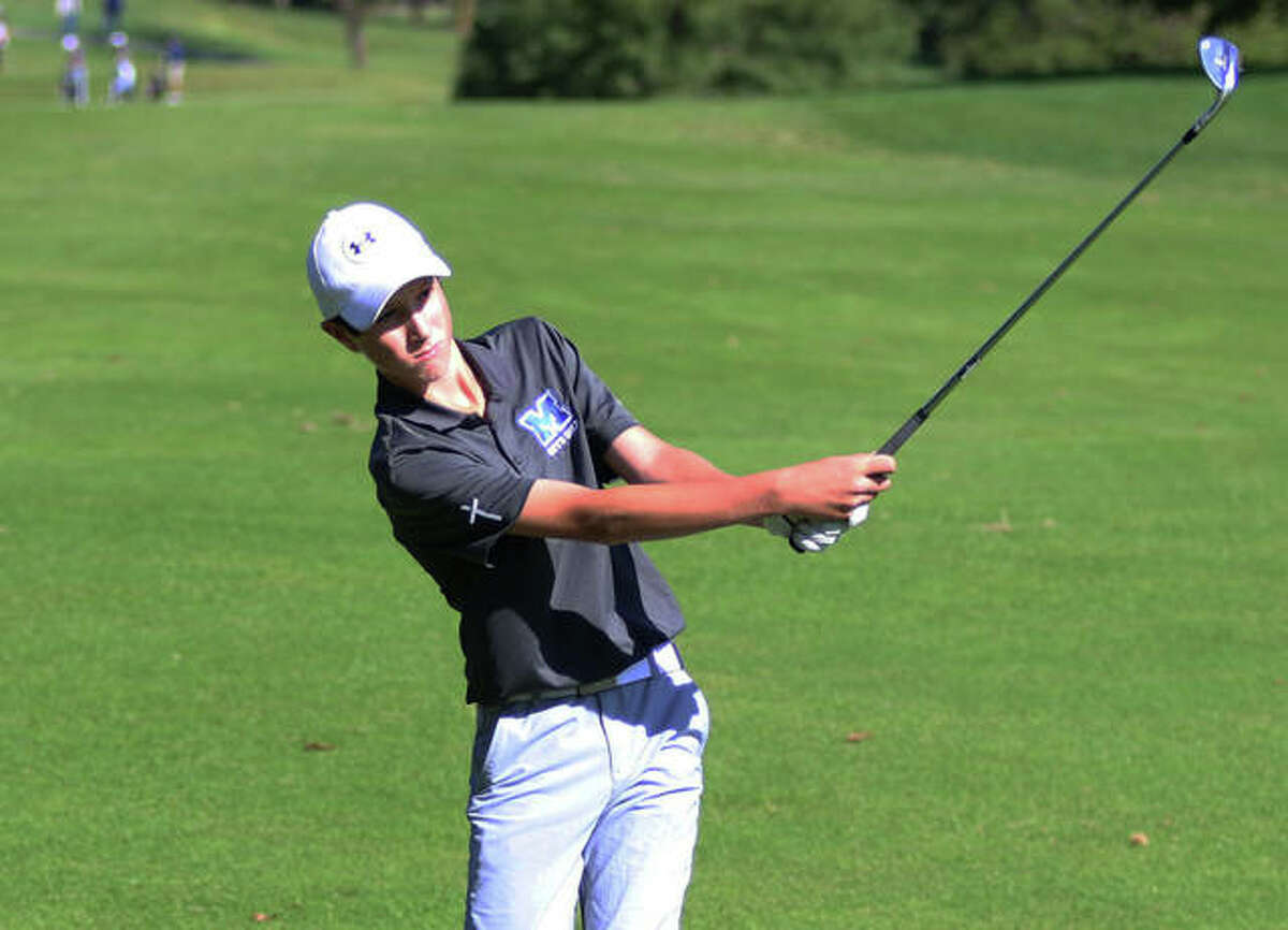 Marquette Catholic freshman Aidan O'Keefe hits a shot at the Marquette Class 1A Regional Oct. 7 at Spencer T. Olin in Alton. On Monday in a sectional at West Frankfort, O'Keefe shot 78 and was eliminated in a four-player playoff for two state berths.