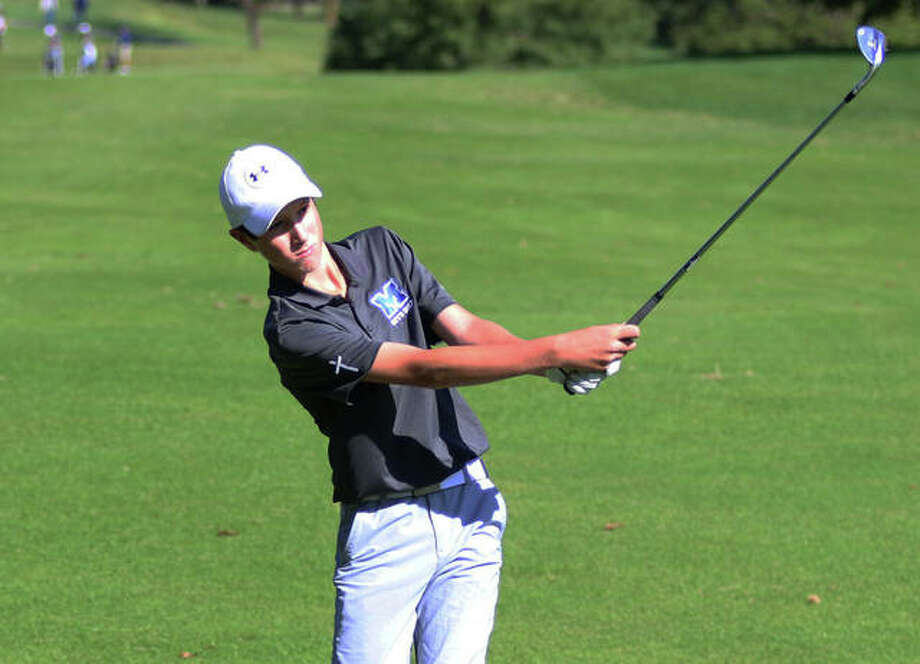 Marquette Catholic freshman Aidan O'Keefe hits a shot at the Marquette Class 1A Regional Oct. 7 at Spencer T. Olin in Alton. On Monday in a sectional at West Frankfort, O'Keefe shot 78 and was eliminated in a four-player playoff for two state berths. Photo: Greg Shashack / The Telegraph
