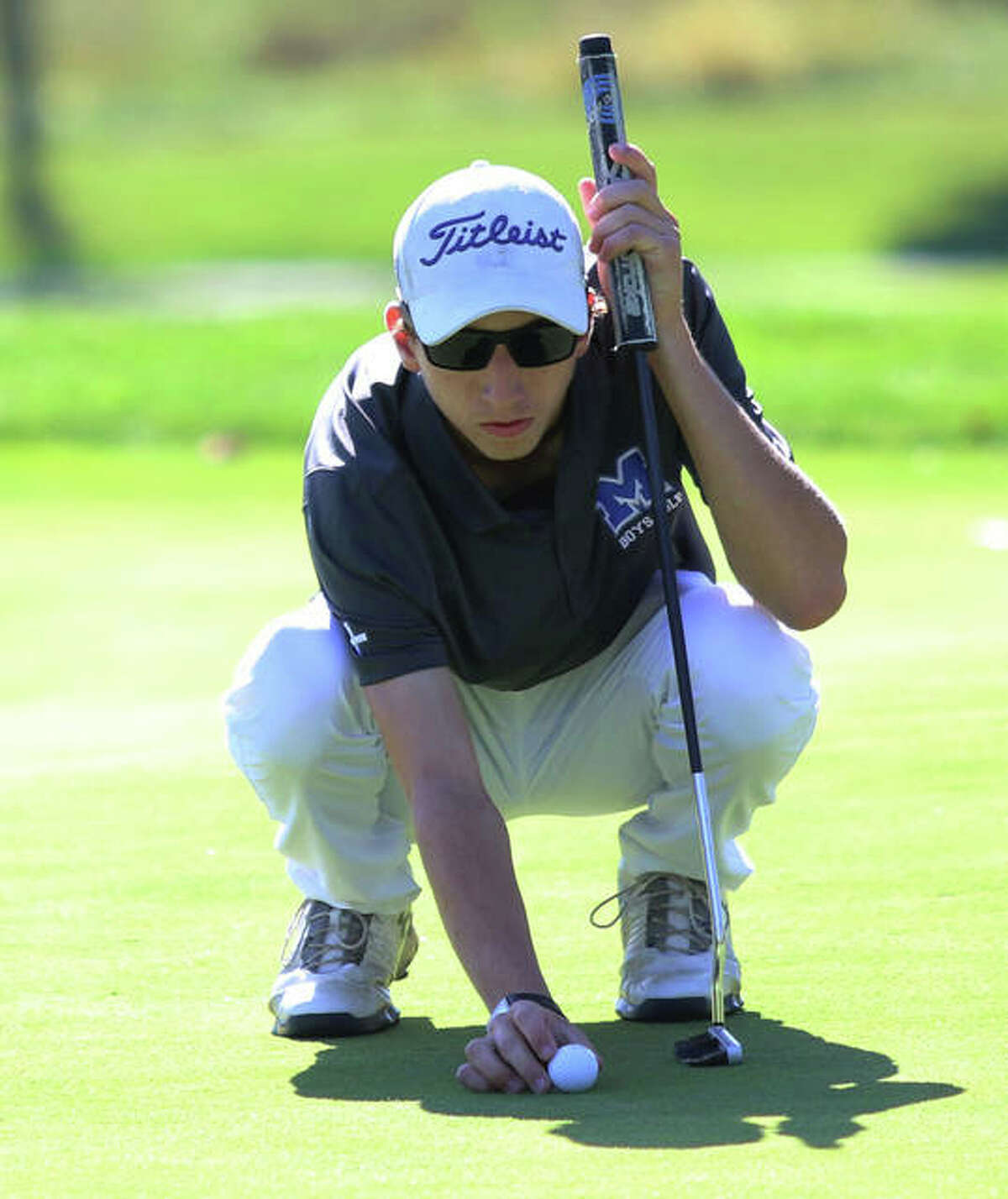 Marquette's William Roderfeld lines up a putt in the Class 1A regional last week at Olin. Roderfeld's junior season ended with an 83 in the sectional in West Frankfort.