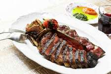 Bistecca Fiorentina (44 Farms steak served with potatoes, fennel, pickled peppers and red and green sauces at Rosalie Italian Soul.