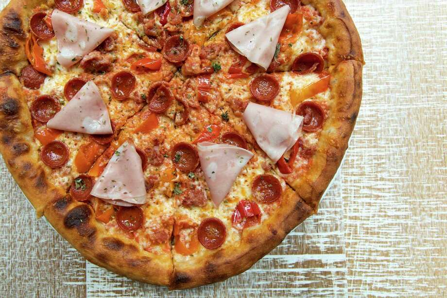 Pictured: Meat lover's pizza with pepperoni, sausage and mortadella at Rosalie Italian Soul.