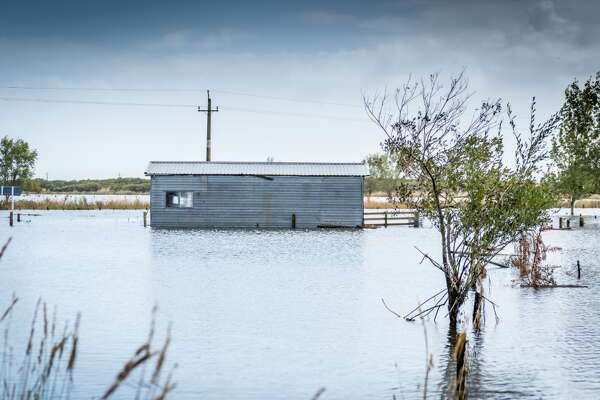 "States with the most homes at risk of flooding While it's difficult to attribute any specific storm to climate change, scientists agree that overall, extreme weather events are increasing in frequency and intensity because of the Earth's changing climate. There have already been five category-5 hurricanes in the Atlantic Ocean in the past four hurricane seasons, and many others that were category 4 or 3 by the time they hit land in the United States. This increase in extreme weather events has caused flooding, especially in U.S. coastal states. However, despite flooding increases, building in some states is increasing in flood-prone areas. According to a joint report conducted in July 2019 by Climate Central and Zillow, new homes are being built in Connecticut 3.5 times faster in risk zones than in safer locations. In Delaware, Mississippi, New Jersey, and Rhode Island, the rate is twice as fast as other, more safe areas. Also, Florida, New Jersey, and North Carolina combined have built more than 9,000 homes in risk zones since 2010. The report, ""Ocean at the Door: New Homes and the Rising Sea,"" determined which states have the most homes at risk of flooding using the metric of how many homes they would build in a 10-year flood zone by 2050. A 10-year flood zone refers to an area that has a 10% chance of flooding annually. These zones were determined based on a moderate greenhouse-gas emissions scenario with a Representative Concentration Pathway of 4.5, meaning that, under this projection, emissions would peak in 2040 and then decline. Using data from the report, Stacker has compiled a list of the 24 coastal states, plus Washington D.C., and ranked them based on how many homes each will have in a 10-year flood zone by 2050. This list also includes information about which states are building the most homes in these risky areas, which are trying to curb new building, and which already have experienced unprecedented flooding. To determine the states with the most homes at risk of flooding, Stacker worked with the Climate Central and Zillow joint July 2019 report, ""Ocean at the Door: New Homes and the Rising Sea."" Climate Central investigated 24 coastal states and the District of Columbia to determine how many homes would be located in 10-year flood zones in 2050 under the Representative Concentration Pathway of 4.5, a moderate greenhouse emissions scenario. Then, Zillow attached property values to these homes. The states are ranked here based on how many total homes will be at risk. This story also includes new homes that will be located in 10-year flood zones; new homes refers to dwellings built between 2010 and 2017 for most states, or between 2010 and 2016 in Alabama, Florida, Mississippi, and New York. Ten-year flood zones refer to areas that have a 10% chance of flooding annually. Read on to discover which states have the most homes threatened by flood risk. You may also like: 50 common weather terms, explained This slideshow was first published on theStacker.com"
