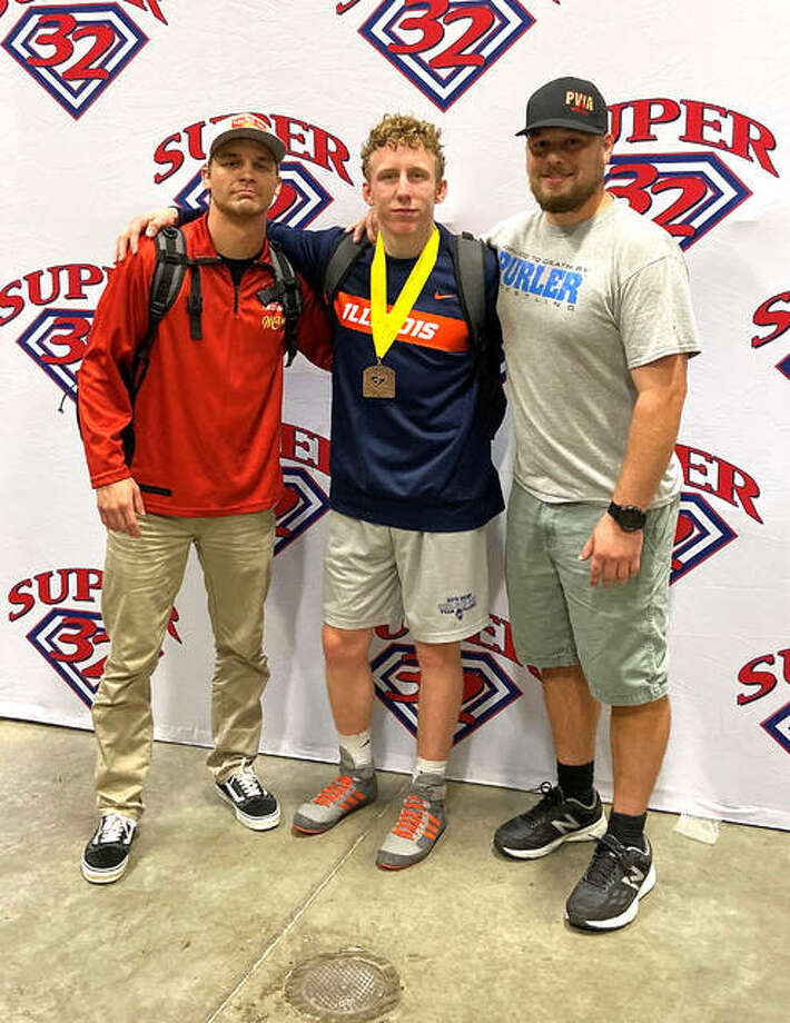 Edwardsville senior Luke Odom, middle, is flanked by coaches Trevor Feagans, left, and Chad Lunn after taking fourth place at 152 pounds in the Super 32 Challenge, held Saturday and Sunday at Greensboro Coliseum in Greensboro, N.C.