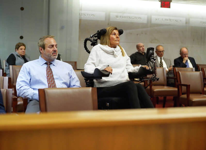 Scott Shapiro and his wife Deanna Shapiro listen to arguments at the New York State Supreme Court, Appellate Division, Third Judicial Department on Tuesday, Oct. 15, 2019, in Albany, N.Y. An attorney was making an appeal argument on behalf of John Cole who was convicted and sentenced to 7 years in prison for an alcohol-impaired crash in Halfmoon that caused Deanna's injuries. (Paul Buckowski/Times Union)