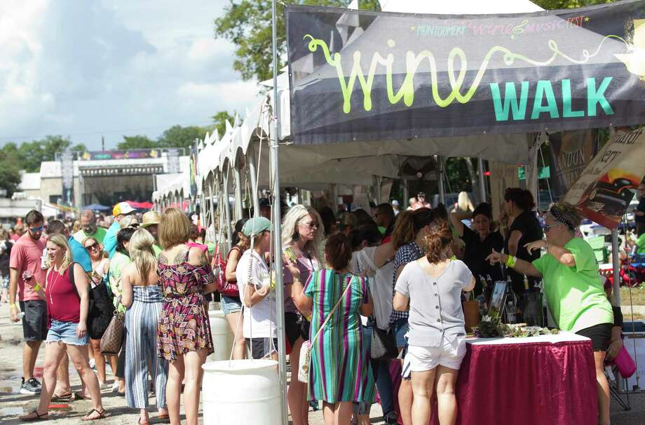 during the annual Montgomery Wine and Music Festival, Saturday, Sept. 21, 2019, in Montgomery. Hundreds of visitors sampled from more than 40 different Texas wines and enjoyed in live music. Photo: Jason Fochtman, Houston Chronicle / Staff Photographer / Houston Chronicle