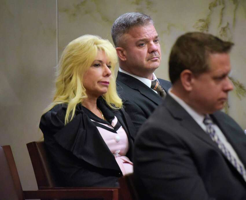 Regina Cole and her husband, John Cole, listen to arguments at the New York State Supreme Court, Appellate Division, Third Judicial Department on Tuesday, Oct. 15, 2019, in Albany, N.Y. John Cole's attorney was making an appeal argument on behalf of Cole who was convicted and sentenced to 7 years in prison for an alcohol-impaired crash in Halfmoon that injured Deanna Shapiro, a passenger in his car. (Paul Buckowski/Times Union)