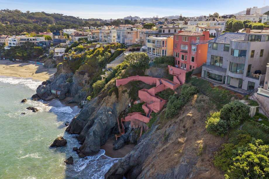 A seven-bedroom, six-bathroom home in San Francisco's Sea Cliff neighborhood offers views of the Golden Gate Bridge, Marin Headlands, Baker Beach and the Pacific Ocean. The well-located property at 224 Sea Cliff Ave. is listed for $15 million. Photo: Open Homes Photography For Sotheby's International Realty
