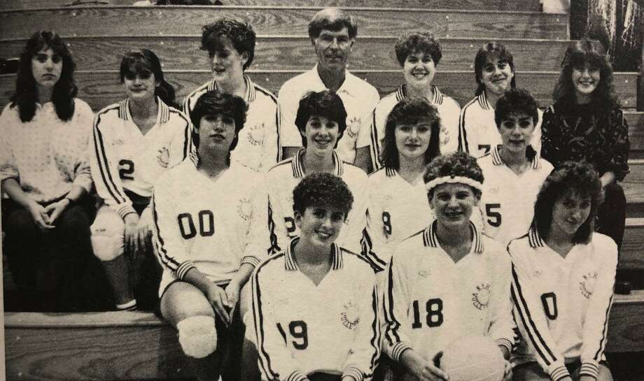 """The New Milford High School volleyball team for the academic year 1986-87 had """"the talent, the skills and the enthusiasm"""" for a good season, according to the school yearbook. Team members that year included, from left to right, in front, captains Jennifer Pasciak, Jenny Renninger and Melodie Paskowski; second row, Lourdes Delgado, Noreen Cahill, Elizabeth Kokke and Sherry Minotti; third row, Mary Hoburg, Gina Daddona, Coleen McCormack, Coach Bill Kraft, Jennifer Kraft, J. Bourdillion and M. Hayes. If you have a """"Flashback"""" photograph to share, contact Deborah Rose at drose@newstimes.com or 860-355-7324. Photo: Courtesy Of New Milford High School 1987 Yearbook / The News-Times Contributed"""