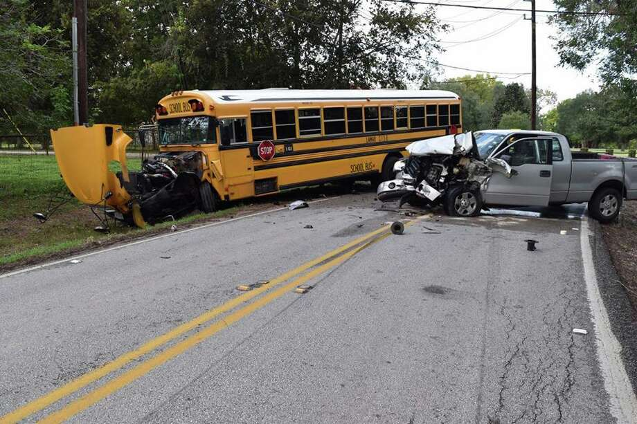 A Lamar Consolidated ISD school bus was struck by a silver pick up truck on Oct. 11. The driver of the pick up truck then fled the scene on foot Photo: Courtesy Photo