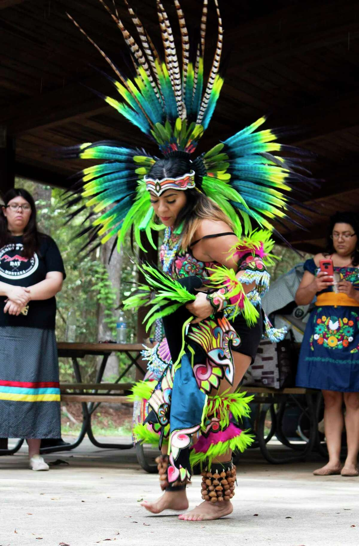 Maribel Garcia with Danza Azteca Taxcayolot performed a dance to the beat of drums in Jesse Jones Park on Oct. 14 celebrating Indigenous People's Day.