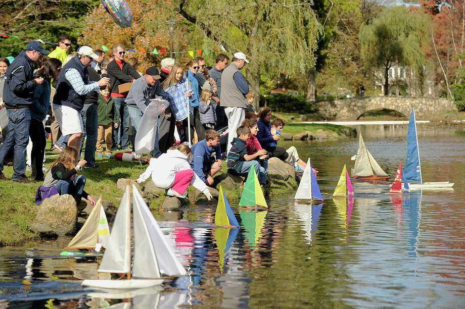 Contestants release their sailboats for the second race of the day during the 51st annual Old Greenwich-Riverside Community Center Sailboat Regatta at Binney Park in Greenwich in 2014. The event returns October 20. Photo: Jason Rearick / Hearst Connecticut Media File Photo / Stamford Advocate