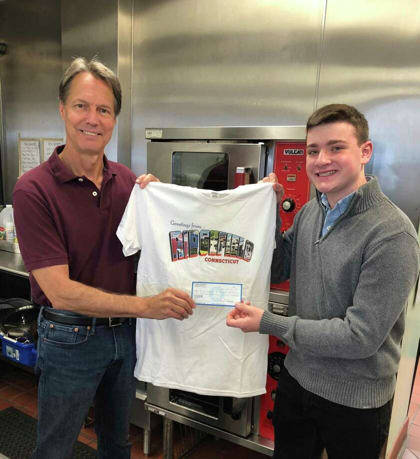 Dean Miller, Chair of Ridgefield Meals on Wheels, receives a donation check from Ridgefield High School senior Sam Sulzinsky. Photo: Theresa Miller / Contributed Photo