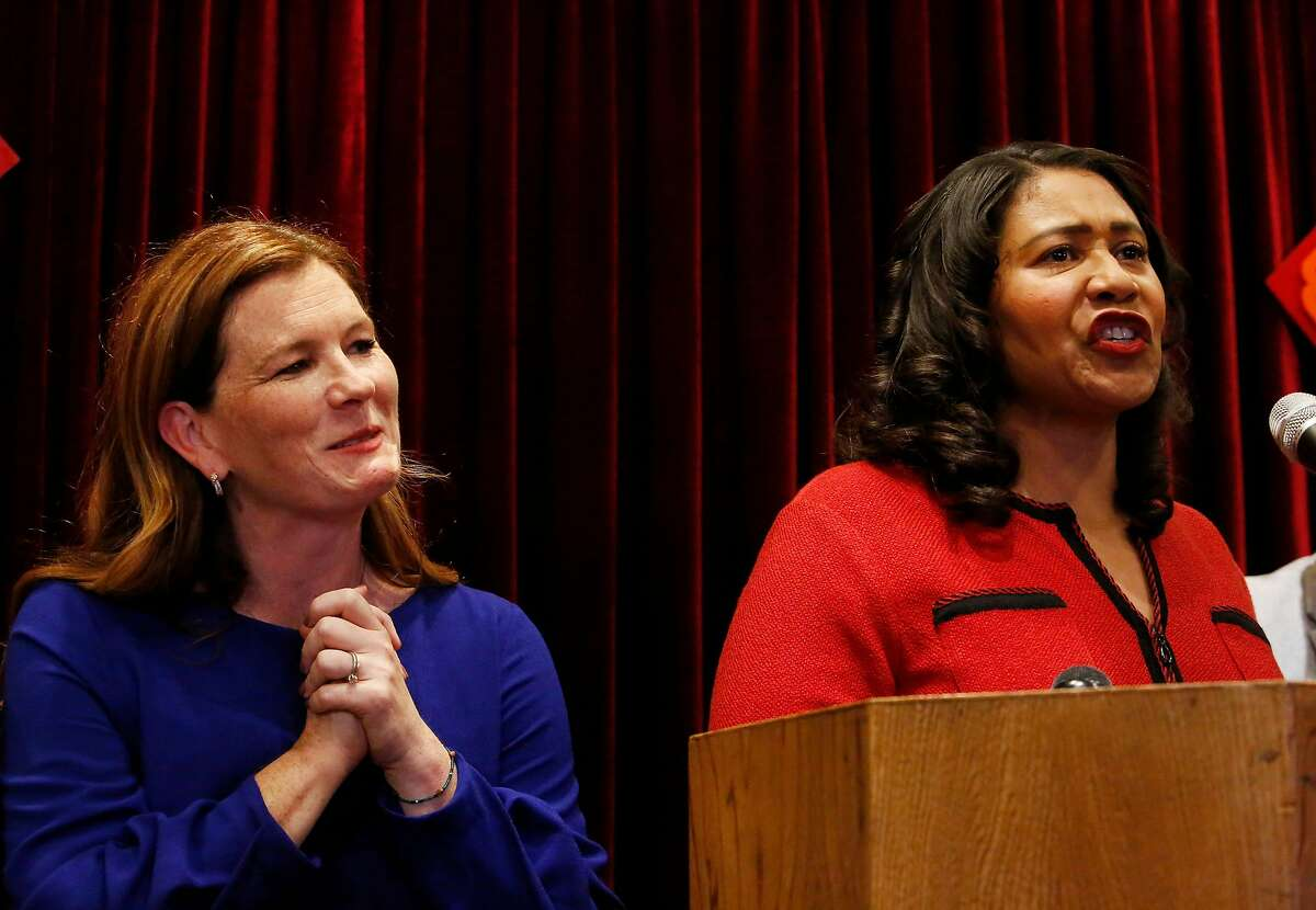 Suzy Loftus (l to r), interim district attorney, stands with Mayor London Breed (right) as she speaks at a press conference at Far East Cafe regarding the appointment of Suzy Loftus (left) as interim district attorney on Friday October 4, 2019 in San Francisco, Calif.