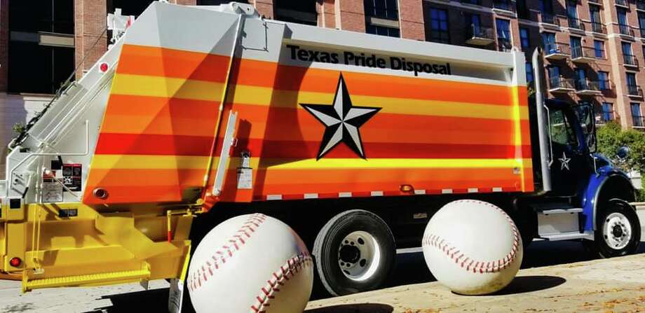 Texas Pride Disposal decorates one of their Houston garbage trucks ahead of the Astros' game on Tuesday. Photo: Courtesy Of Texas Pride Disposal