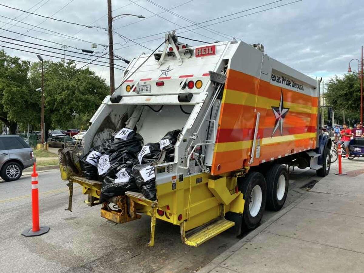 Texas Pride Disposal decorates one of their Houston garbage trucks ahead of the Astros' game on Tuesday.