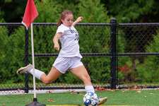 Mia Pepitone delivers a corner kick during a recent Wilton girls soccer game.