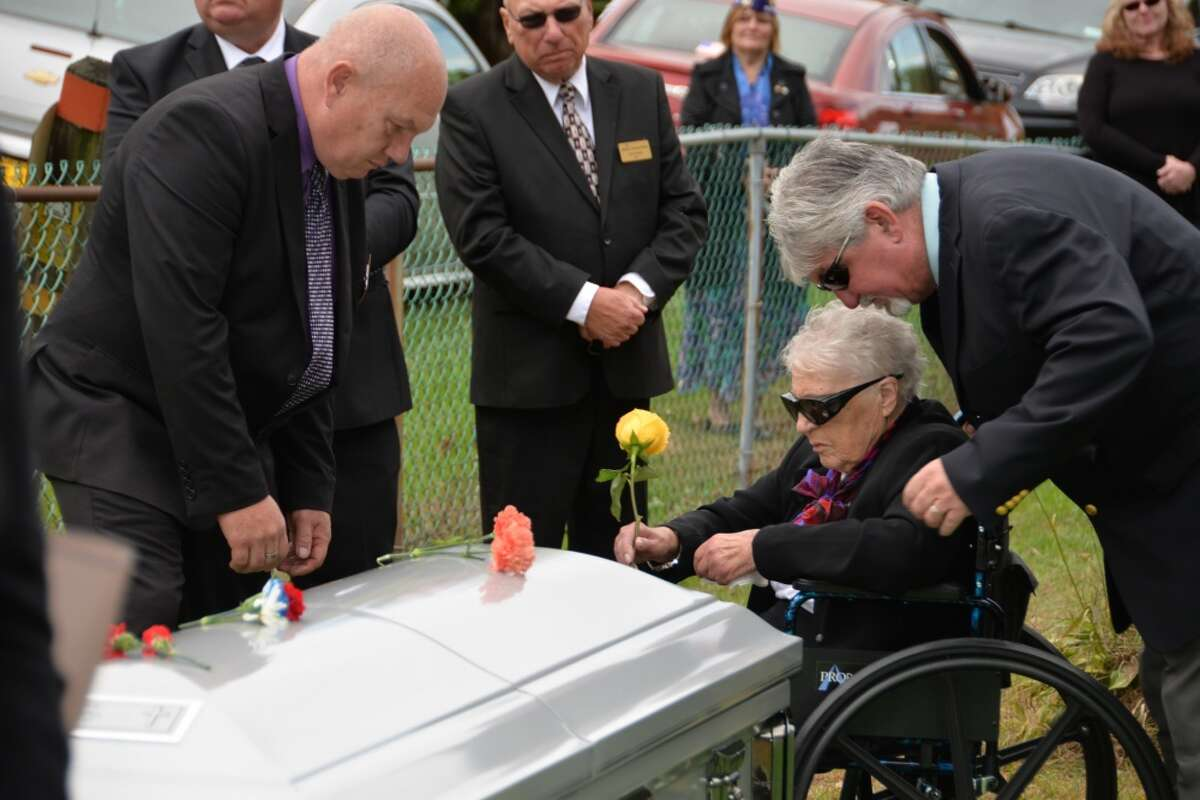 Wilma Currey, with family members, places flowers on the casket of her husband, Medal of Honor recipient Sgt. Francis S. Currey at the Mt. Pleasant Cemetery in South Bethlehem, N.Y., October 12, 2019. Currey, 94, from Selkirk, N.Y., died October 8. He received the Medal of Honor for valor displayed as an infantryman during the Battle of the Bulge in World War II. Members of the New York Military Forces Honor Guard provided military honors for the funeral service. (U.S. National Guard photo by Col. Richard Goldenberg.)
