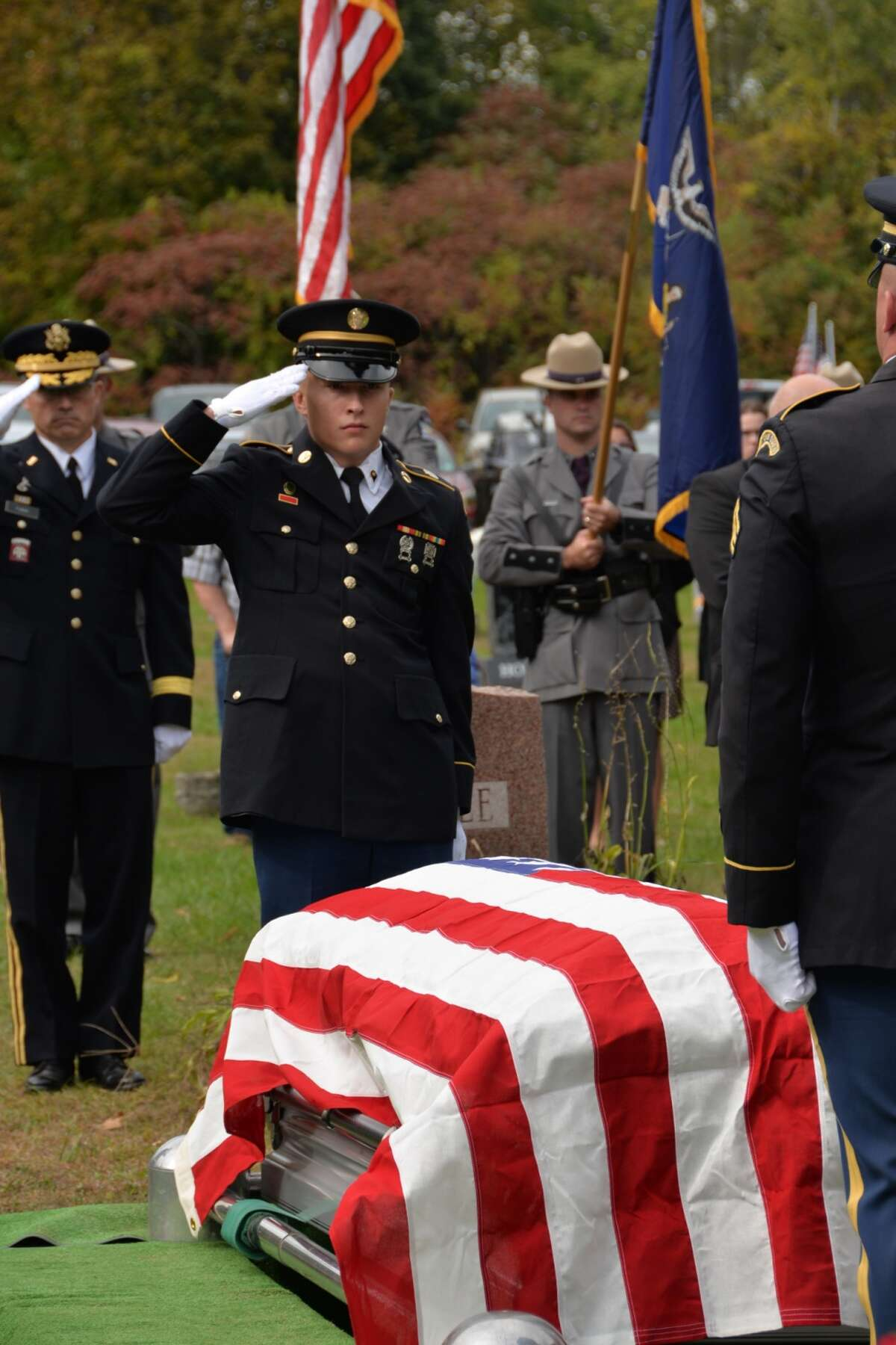 New York Army National Guard Spc. Ryan Gosse, center, and Army Brig. Gen. Brett Funck, Deputy Commanding General of the 10th Mountain Division, render graveside honors during the funeral of Army Medal of Honor recipient Tech. Sgt. Francis S. Currey at the Mt. Pleasant Cemetery in South Bethlehem, N.Y., October 12, 2019. Currey, 94, from Selkirk, N.Y., died October 8. He received the Medal of Honor for valor displayed as an infantryman during the Battle of the Bulge in World War II. Members of the New York Military Forces Honor Guard provided military honors for the funeral service. (U.S. National Guard photo by Col. Richard Goldenberg.)