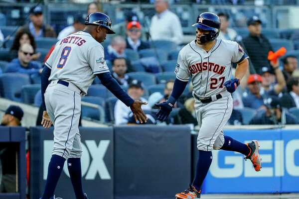 Houston Astros second baseman Jose Altuve (27) rounds third after hitting a solo home run into left center field during the first inning of Game 3 of the American League Championship Series at Yankee Stadium in New York on Tuesday, Oct. 15, 2019.