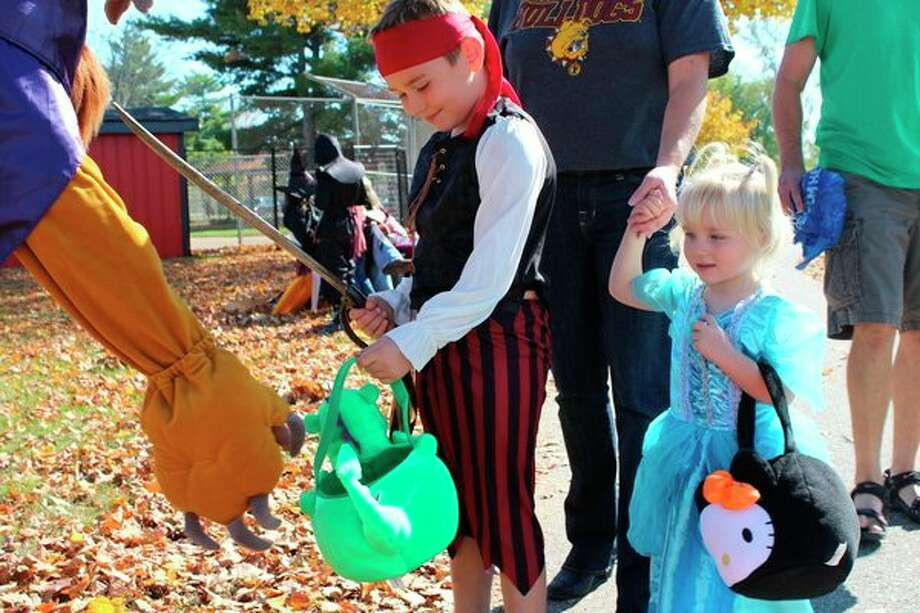 Children participate in a previous Halloween in the Park. This year, it will take place on Saturday, Oct. 26. (Herald Review file photo)