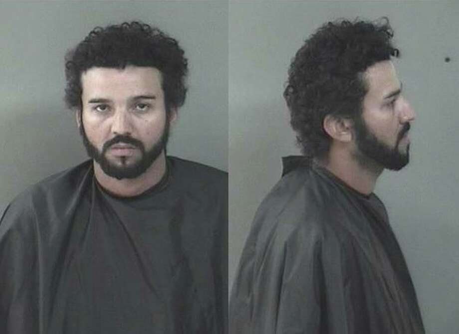 Douglas Rivas, 34, poses for a mug shot after being arrested in Florida in connection with a murder in a Bridgeport restaurant. Photo: Contributed Photo / INDIAN RIVER COUNTY SHERIFF'S OFFICE / Contributed Photo / Connecticut Post