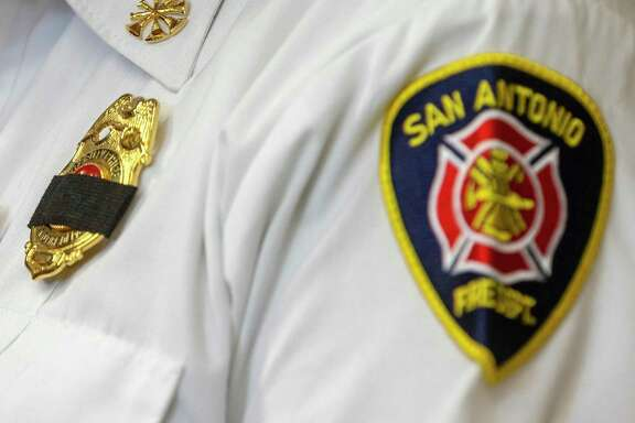 A member of the San Antonio Fire Department command staff wears a black band over his badge during a press conference Tuesday, Oct. 15, 2019, at Public Safety Headquarters where it was announced firefighter Greg Garza had died of injuries in what appears to be an accident while he was on a call. A motorist hit him after he apparently stumbled and fell while trying to exit a fire truck, according to Fire Chief Charles Hood.