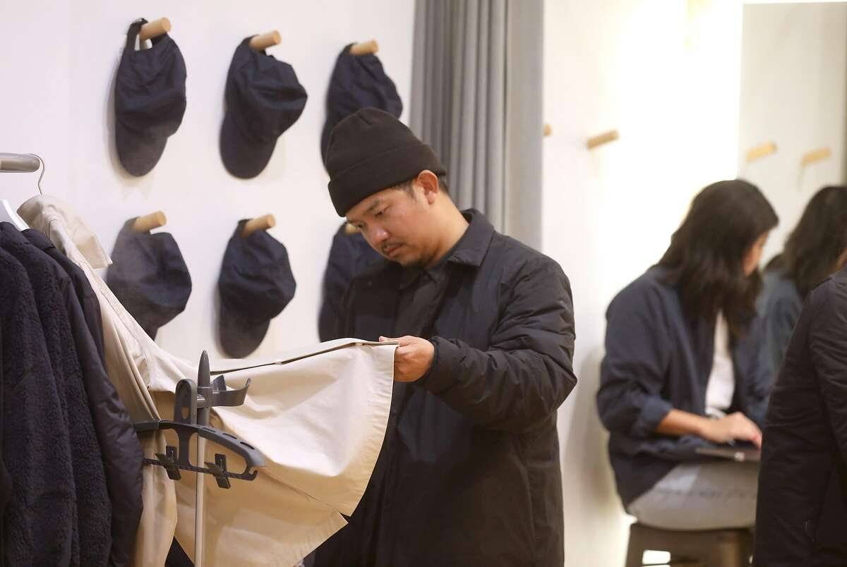 Wardrobe stylist Emerson Aquino checks clothes on display at Hill City, a new men�s wear pop-up store in Hayes Valley openening today on Tuesday, Oct. 15, 2019, in San Francisco, Calif.