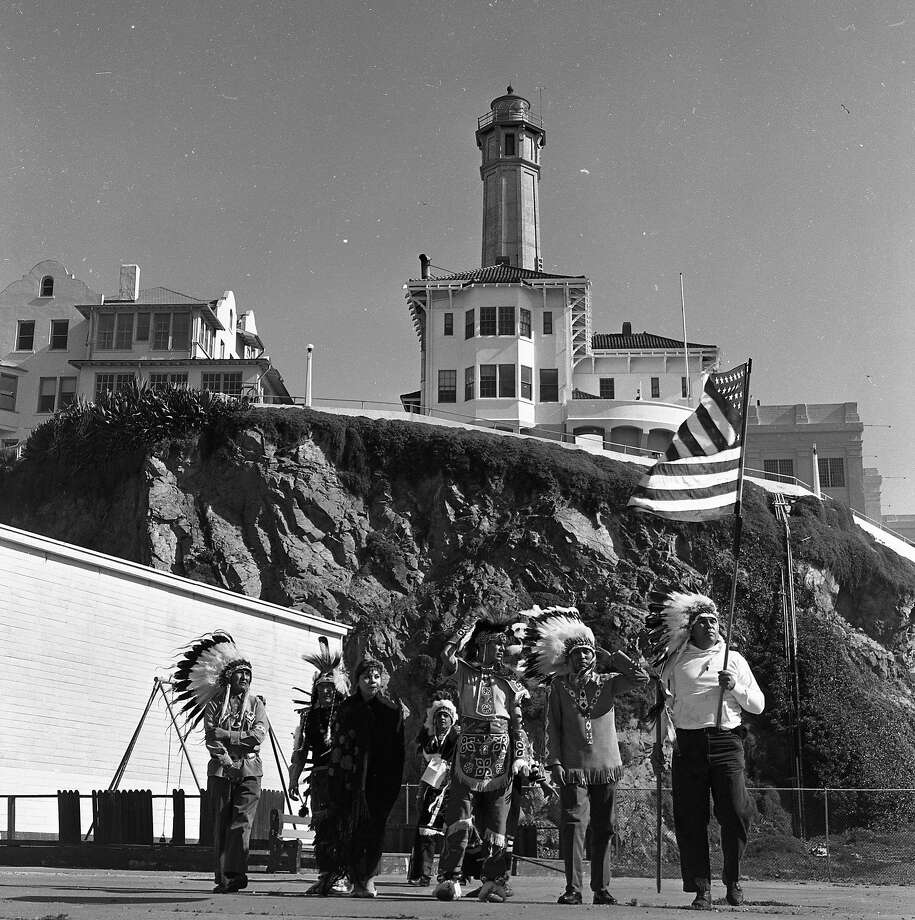 Five Sioux Indians arrive at Alcatraz Island and hammer stakes in the ground as a first step to claiming the property on March 8, 1964. Photo: Barney Peterson / The Chronicle 1964