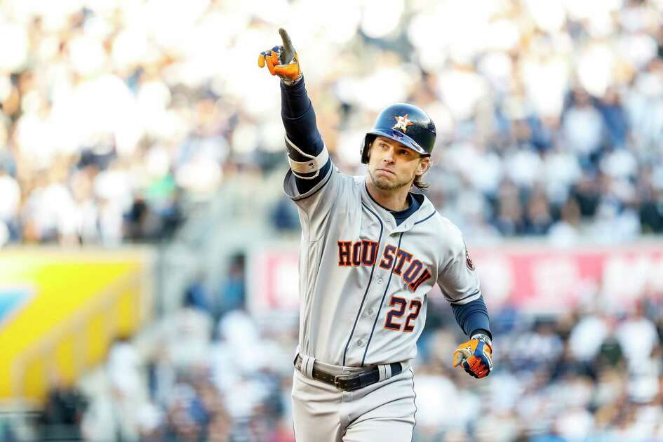 Houston Astros right fielder Josh Reddick (22) rounds the bases after hitting a solo home run during the second inning of Game 3 of the American League Championship Series at Yankee Stadium in New York on Tuesday, Oct. 15, 2019.